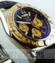 Begagnad-Breitling-Chronomat-CB042012-18-gummi-svart-detalj-urtavla